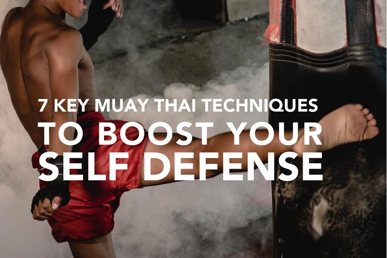 Kicking heavy bag with muay thai techniques